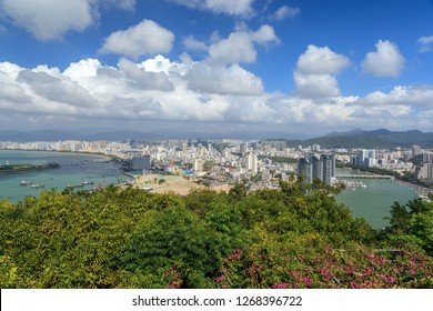 China, Hainan Island, Pheonix Island  - December 2, 2018: Panorama of Sanya City Bay,Pheonix Island Sanya, illuminated buildings. Phoenix island sanya, is a chinese marvel, editorial