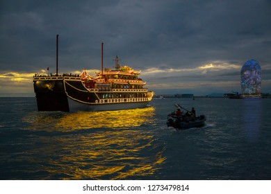China, Hainan Island, Pheonix Island  - December 2, 2018: pleasure boat with tourists in the evening bay of Sanya Bay, editorial.