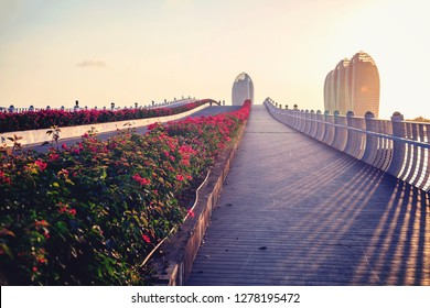 China, Hainan Island, Pheonix Island  - December 2, 2018: Panorama of Sanya City Bay, Bridge to Phoenix Island, in the rays of a sunset. Phoenix island sanya, is a chinese marvel, editorial