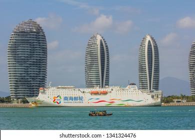 China, Hainan Island, Pheonix Island - December 28, 2018: Pheonix Island Sanya, illuminated buildings.Orange Bronze, Unique modern design. Phoenix island sanya, is a chinese marvel.