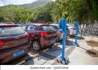 China, Hainan Island, Sanya bay - December 2, 2018: Charging modern electric car on the street of China, editorial