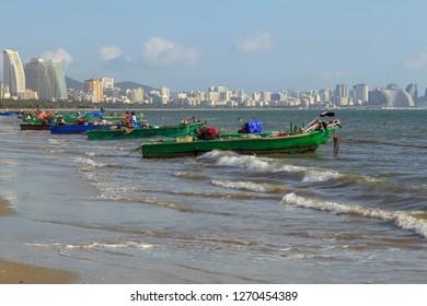 China, Hainan Island, Sanya bay - December 2, 2018:Sanya bay,fishing boats on the beach of Sanya, editorial.