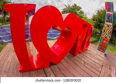 China, Hainan Island, Sanya bay - January 3, 2019. Celebration of St. Valentine's Day on the tropical islands. luxury vacation. Inscription love on the background of exotic palms .