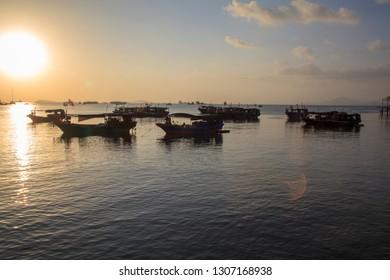 China, Hainan Island, Sanya bay  - December 2, 2018: Sanya bay, pier and boats in the sea bay, editorial.