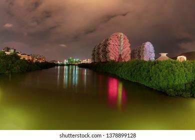 China, Hainan Island, Sanya bay - December 2, 2018: hotel 7-star hotel Sanya`s Beauty Crown, hotel houses trees in Sanya, Evening panorama, editorial