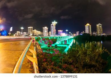China, Hainan Island, Sanya bay - December 2, 2018: Night panoramic of Sanya city, view on the bridge, editorial.