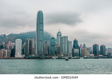 CHINA, HONG KONG - JANUARY 13, 2017: The modern developed Chinese city of Hong Kong, Victoria Harbor, overcast and foggy weather.