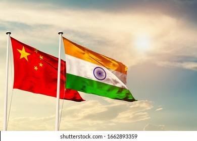 China India national flag cloth fabric waving on the sky with beautiful sun light - Image