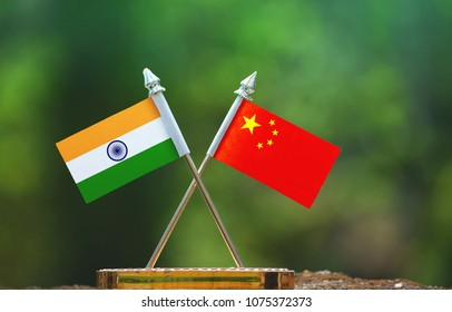 China and India small flag with blur green background