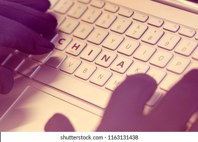 CHINA inscription on laptop keyboard. Hacker man using a laptop attacks the web. Cyberattack, online theft of personal data and cybercrime concept
