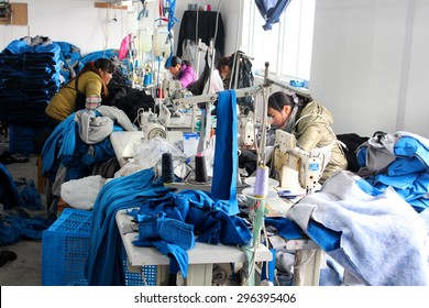 CHINA - JANUARY 15: Chinese clothes factory with seamstresses, January 15, 2013 in China