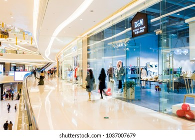 CHINA - January 23: Slightly defocused crowd of walking people in the newly opened shopping mall center on January 23, 2018 in China.