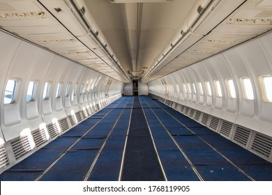 China, Jinan, June 2020, cabin of modern commercial aircraft (airliner) with all passengers seats removed - empty passenger cabin, only carpet remaining in cabin