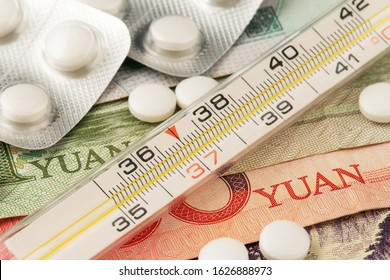 China Medicine Yuan Mercury thermometer and medicine blister with prescription pills on China Yuan currency banknotes.