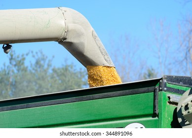 CHINA, MI, USA / NOVEMBER 14, 2015: A combine transfers corn to grain cart in a China, MI field on November 14, 2015. China is in St Clair County, MI which is a rural area with many small farms.