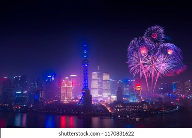 china nation day celebrate night in Shanghai city with celebration freworks and light from modern city skyscrapers and reflection of beautiful ligth in Huangpu river, Shanghai, China