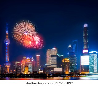 china nation day celebrate night in Shanghai city with celebration fireworks and light from modern city skyscrapers and reflection of beautiful ligth in Huangpu river, Shanghai, China