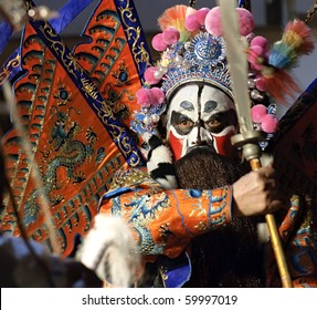 china opera actor with theatrical costume and facial painting