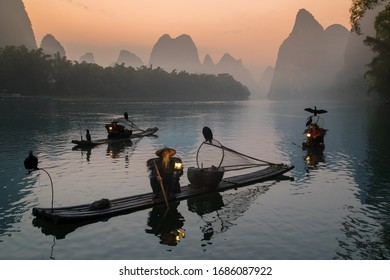 China River Li - June 03.2019 Old fishman with gannets on the Li River, China