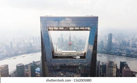 CHINA, SHANGHAI - AUGUST 4, 2018. Frame Of Shanghai Skyline. Oriental Pearl Tower Through Shanghai World Financial Center.