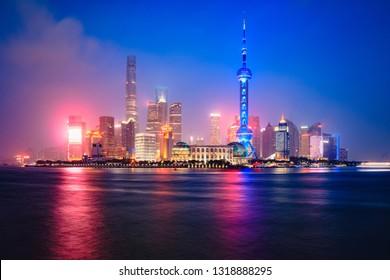 China Shanghai city skyline at dusk with reflection, Shanghai China