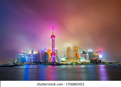 China, Shanghai - October 19, 2019: View from The Bund of The Oriental Pearl Tower, Jin Mao Tower, Shanghai World Financial Center, Shanghai Tower and the Lujiazui Finance and Trade Zone, at night.