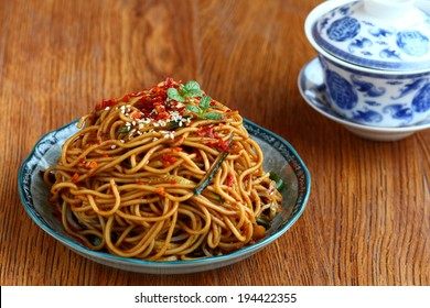 China Sichuan spicy Cold Noodles with Sesame Sauce  and lidded-cup tea