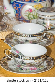 china tea cups with painted floral ornament motifs