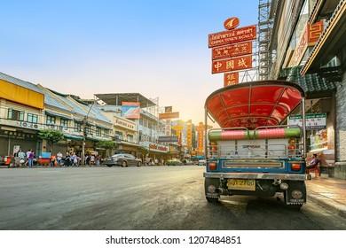 CHINA TOWN, BANGKOK THAILAND - 12 MAY 2018: Sunset at Yaowarat road with Tuk Tuk Taxi, The main street of China Town in Bangkok , Yaowarat is one of the famous landmark of Chinese Arts and Buildings