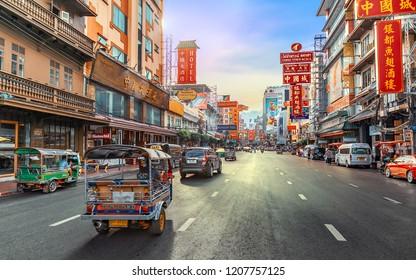 CHINA TOWN, BANGKOK THAILAND - 12 MAY 2018: Sunset at Yaowarat road with Tuk Tuk Taxi, Yaowarat is one of the famous landmark of Chinese Arts and Buildings in Bangkok