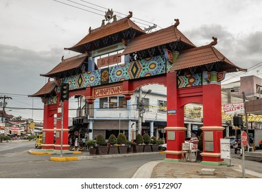 China town of Davao city, Philippines. August 21 - 2016: Red colored and Chinese style Unity Arch gate of China town in city of Davao.