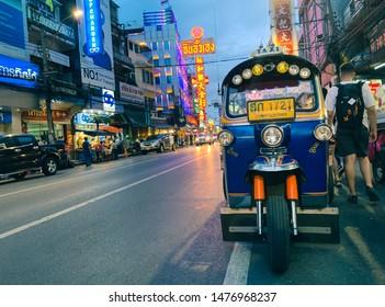 CHINA TOWN YAOWARAT ROD BANGKOK THAILAND - 11/08/2019 : Tuk Tuk rickshaw taxi service stop at china town Yaowarat road