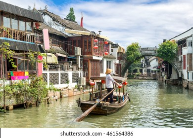China traditional tourist boats on canals of Shanghai Zhujiajiao Water Town in Shanghai, China