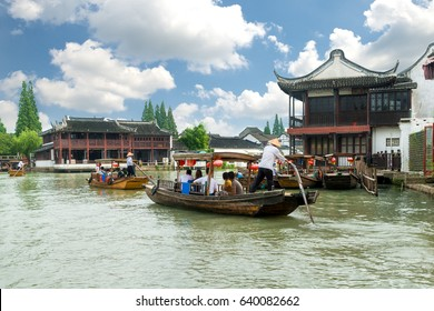 China traditional tourist boats on canals of Shanghai Zhujiajiao Water Town in Shanghai, China.