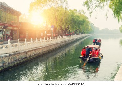 China traditional tourist boats on Beijing canals of Qianhai lake at ShiChaHai district in Beijing, China