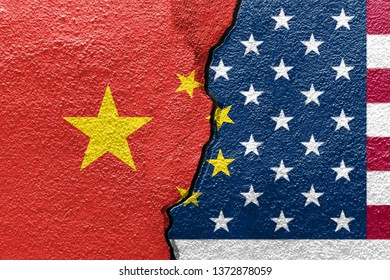 China and U.S.A flags on cracked concrete (International conflict concept)