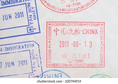 China visa passport stamp on Canadian passport close-up