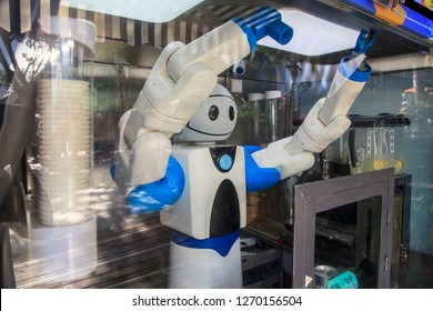 China, Wuzhizhou Island - December 2, 2018: Wuzhizhou Island. The robot sells ice cream in the store. Editorial.