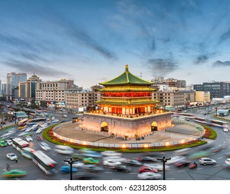 china xian in nightfall, ancient bell tower with vehicles motion blur on rush hour