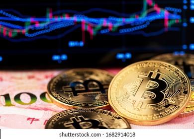 China Yuan Banknotes And Bitcoin Cryptocurrency Coins. Asia Bitcoin China