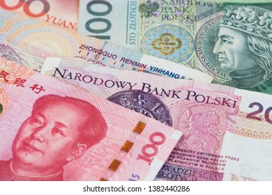 China Yuan Renminbi currency with Poland Zloty banknotes. China Poland Yuan Renminbi Zloty currency