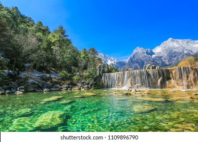 China Yunnan Lijiang Natural Park, Jade Dragon Snow Mountain, waterfalls, lakes and primeval forest