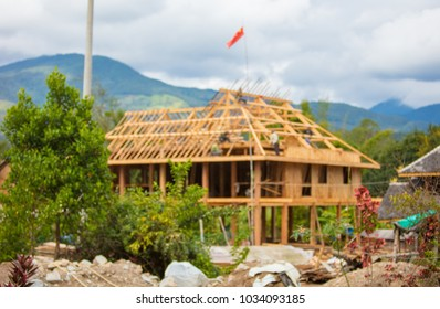 China Yunnan Province, wooden houses construction site, blurred background