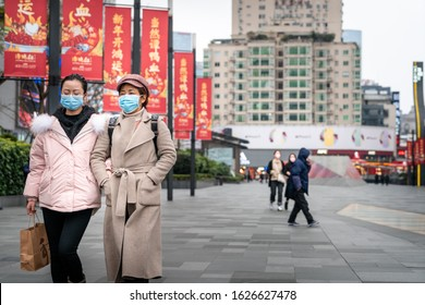 CHINA,CHENGDU,Chunxi Rd.-JANUARY 23,2020: Coronavirus epidemic in China .People wearing face masks. Novel coronavirus (2019-nCoV), people in white medical face mask