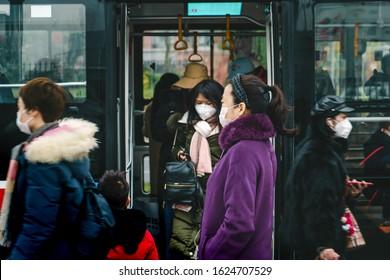 CHINA,CHENGDU,Yinghui Rd.-JANUARY 23,2020: Coronavirus epidemic in China .People wearing face masks. Novel coronavirus (2019-nCoV), people in white medical face mask