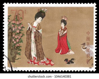 "CHINA-CIRCA 1984: Canceled postage from the People's Republic of China, ""Beauties Wearing Flowers,"" depicting two noblewomen in robes with a crane, by Zhou Fang during the Tang dynasty."