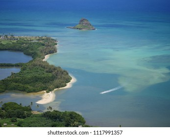 Chinamans hat mokolii island with secret island beach and the open blue ocean view from the mountain Kaneohe bay kuala regional park point Oahu Hawaii fame