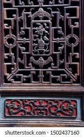 China's ancient wooden window carving grille, with exquisite texture, abstract artistic style. Carved with bats, vases, money symbolizes the meaning of happiness, peace, and wealth.