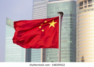 China's flag on the background of skyscrapers of Shanghai World Financial Center