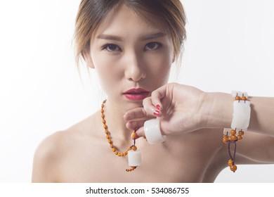 China's white jade jewelry jade cong, bracelet, a jade ring.Closeup beautiful Asian girls wear jade jewelry.